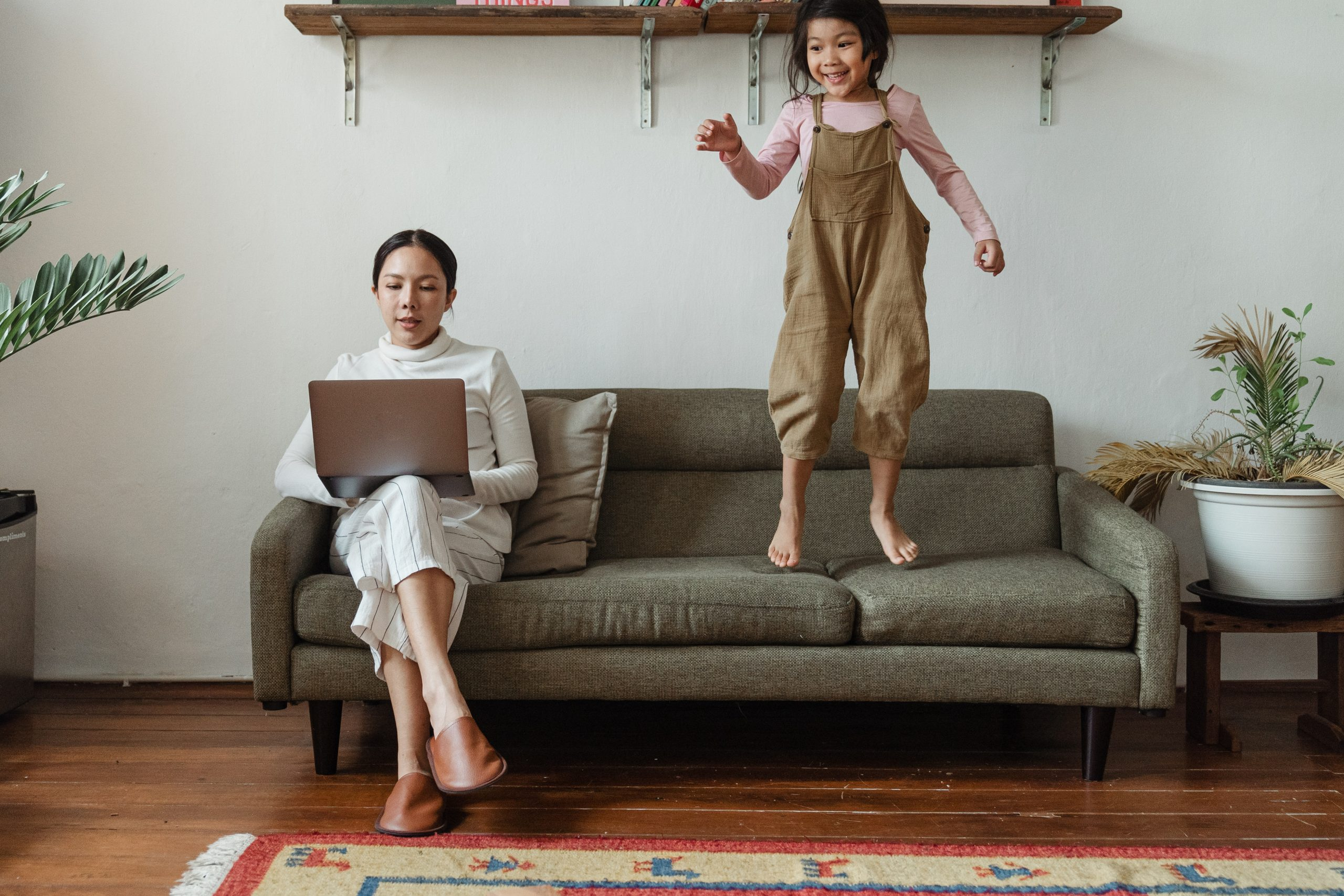 Parent trying to work at home while kid jumps on couch