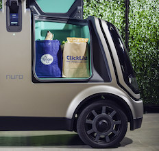 photo of Nuro vehicle with groceries in storage compartment